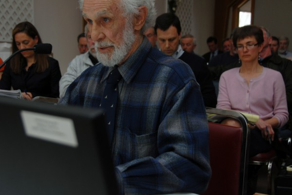 Lakeville resident Gordon Mott speaks against a proposed industrial wind site for Bowers Mountain east of Springfield during a LURC hearing in Lincoln in April 2012.