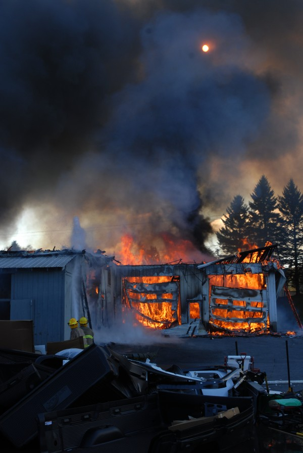 Thick smoke blanketed the area around Valley Auto in Fort Kent on Wednesday morning as crews from seven St. John Valley fire departments fought to contain the blaze.