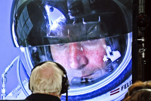 Pilot Felix Baumgartner of Austria is seen on a screen at mission control center in the capsule during the final manned flight for Red Bull Stratos in Roswell, New Mexico, in this October 14, 2012 handout photo.
