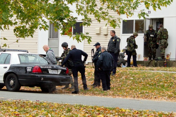 Jared Ross is put in a police vehicle after being arrested Friday in Bangor's Capehart neighborhood.