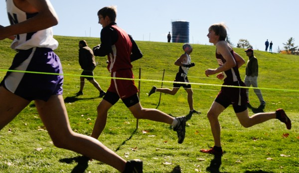 Harriers run a cordoned zig-zag pattern on the early hill section of the boys' varsity PVC Cross Country Championship Meet at Ellsworth High School on Saturday, Oct. 13, 2012.
