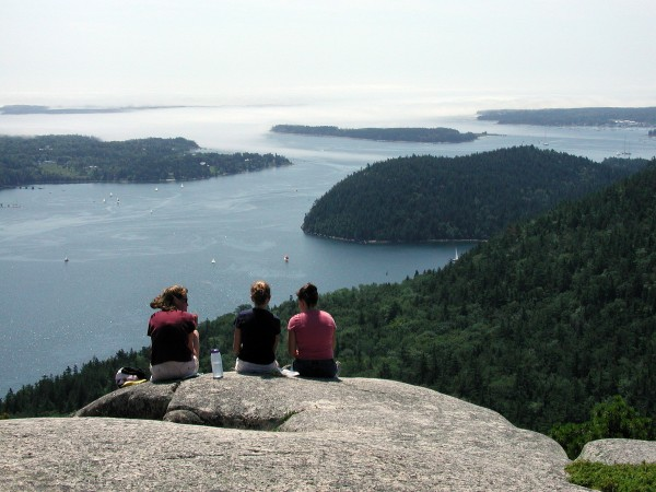 Hikers sit on top of Acadia Mountain, overlooking Somes Sound, in 2003.