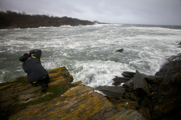 Photographer Charlie Widdis takes pictures of the churning surf near the western tower at Two Lights in Cape Elizabeth on Monday, Oct. 29, 2012 as Hurricane Sandy's winds whipped the shore.