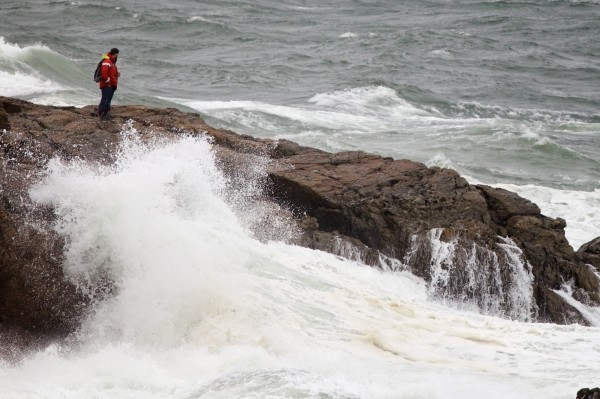 A man watches the surf at Fort Williams Park in Cape Elizabeth on Monday, Oct. 29, 2012 as Hurricane Sandy's weather came ashore.