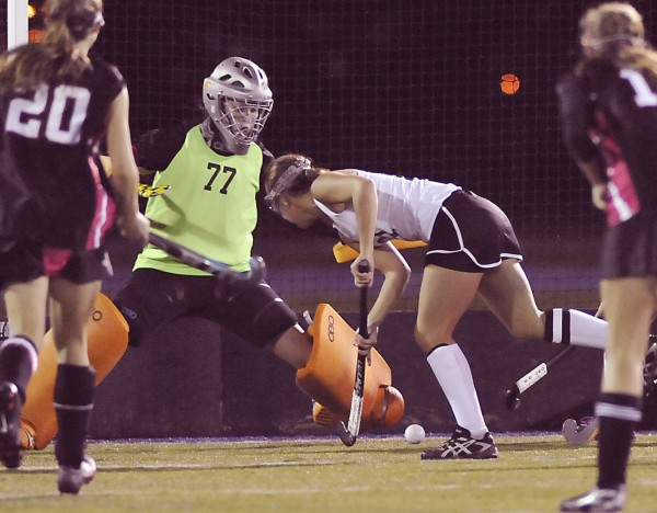 Skowhegan High School field hockey forward Makaela Michonski (center) puts a shot on Scarborough goalie Shannon Hicks in the first half of their State Class A Championship game in Orono, Maine, Saturday, Oct. 27, 2012.