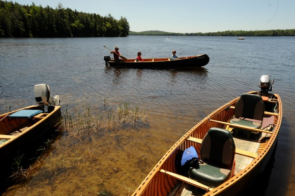 People head out in canoes for a tour of Wabassus Lake after a press conference in June 2008 at the boat landing by the Downeast Lakes Land Trust.