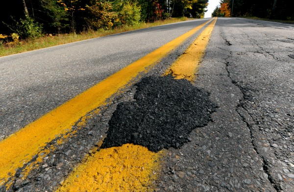 One of the many potholes on Route 69 in Hampden with a patch. The Hampden section of the road is in need of repair.