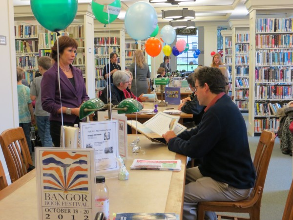 During the sixth annual Bangor Book Festival, a roomful of Maine-based and Maine-connected writers gathered at the Bangor Public Library to sign books last Saturday.