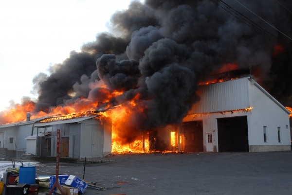 Flames engulf the Valley Auto GMC dealership in Fort Kent on Wednesday morning.