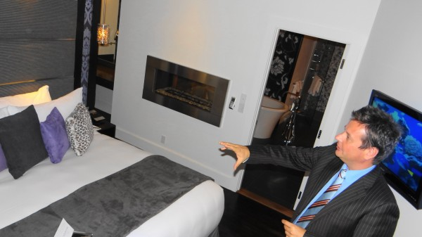 Raymond Brunyanszki shows the bedroom of a luxury suite at the Camden Harbour Inn.