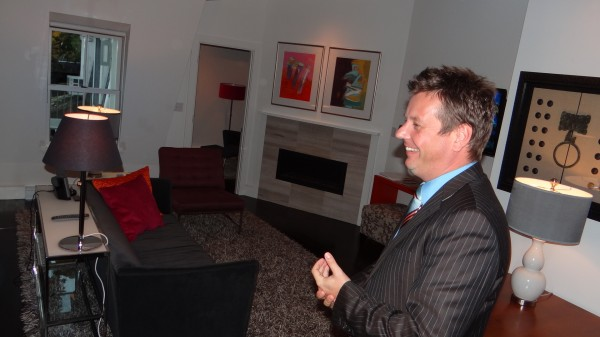 Raymond Brunyanszki gives a tour through the living room of a luxury suite at the Camden Harbour Inn. The suite goes for $985 a night in the summer.