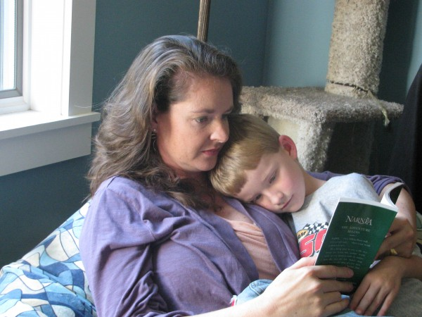Amy Robbins-Wilson reads to her son, 7-year-old Clayton, during a quiet moment after school. Clayton, who nearly died when he was born, inspired his mom to write a lullaby that will be featured in a national advertising campaign for St. Jude Children's Research Hospital.