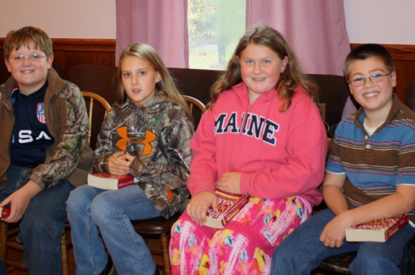 During a visit to Valley Grange hall in Guilford, sixth-graders (from left) Ethan Chadwick, Addyson Herrick, Alison Quimby and Nathaniel Fanjoy talked to third-graders from Piscataquis Community Elementary School about how much they have used the dictionaries they received from Grange members three years ago. The third-graders were at the Grange to receive dictionaries of their own.