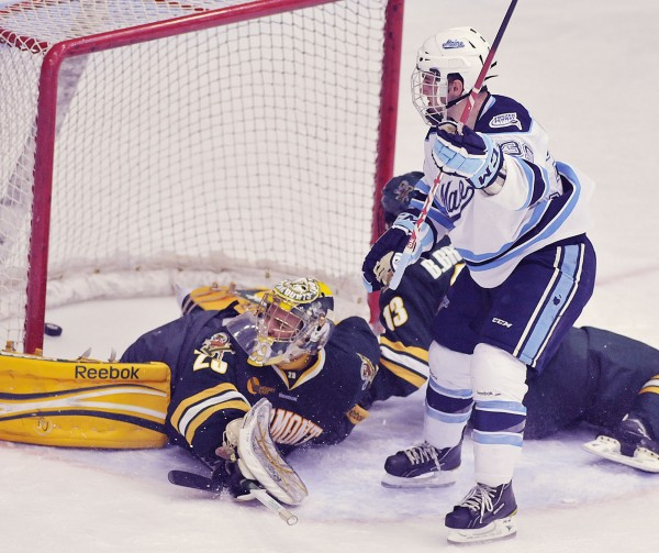 Maine's Joey Diamond (39) one-times a shot past Vermont goalie Rob Madore (29) during a game last January. Diamond was Hockey East's top goal scorer last season and Maine will be looking for similar production this season.