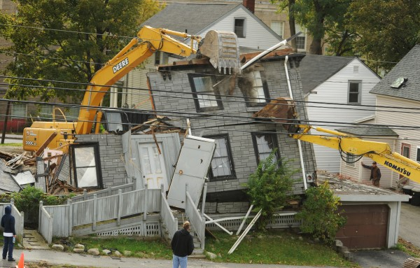 A house on Cumberland street is demolished on Wednesday.