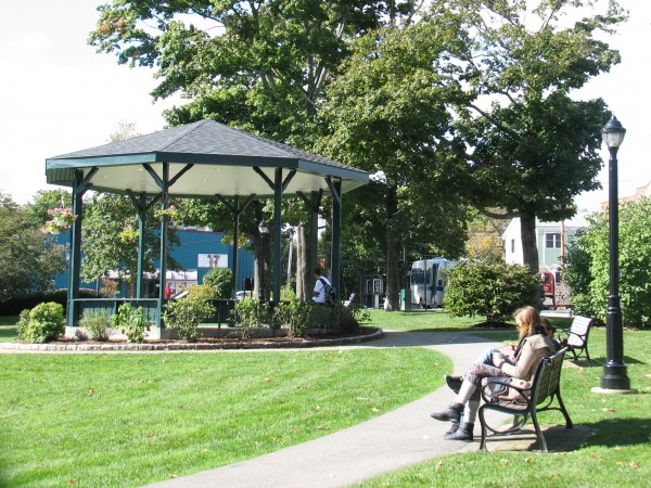 A couple sits on a bench in the Bar Harbor Village Green on Tuesday, Oct. 9, 2012. The green recently was named by American Planning Association as one of the top 10 public spaces in the country for 2012.