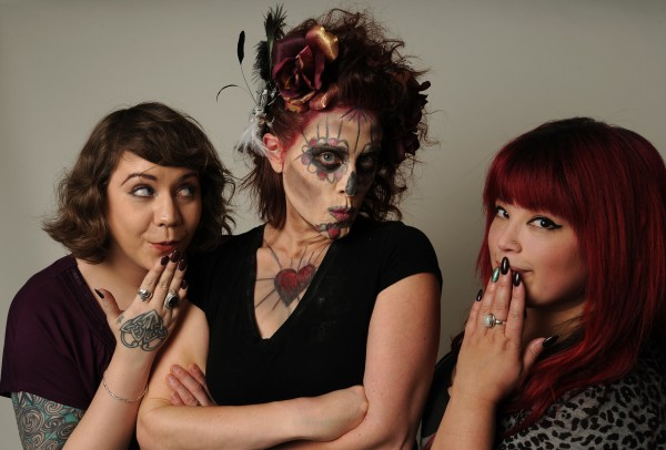 Emily Burnham (center) gets made up by hair stylist Ao Harker (right) and makeup artist Bex Hickman (left) at the BDN studio on Friday, Oct. 12, 2012.