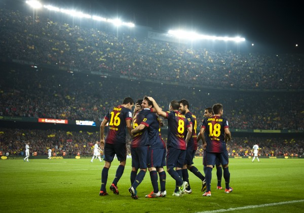 Barcelona's Lionel Messi from Argentina (center) celebrates after scoring a goal against Real Madrid's during a Spanish La Liga soccer match at the Camp Nou Stadium, in Barcelona, Sunday, Oct. 7, 2012.
