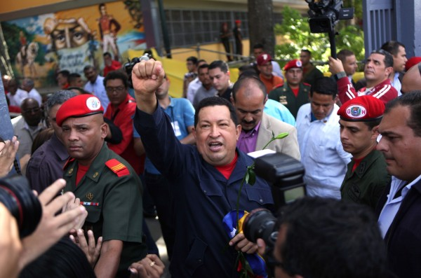 Venezuela's President Hugo Chavez arrives to a polling station during the presidential election in Caracas, Venezuela, Sunday, Oct. 7, 2012.