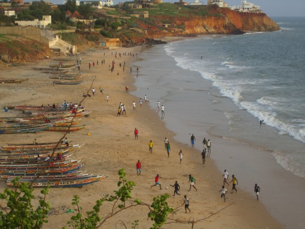 Children on school vacation enjoy the beach in Toubab Diallo, a town about an hour south of the capital city of Dakar.
