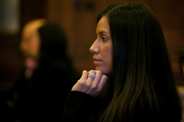 Alexis S. Wright, 29, of Wells listens Tuesday, Oct. 9, 2012, in Cumberland County Superior Court in Portland, where she was arraigned on 106 criminal charges.