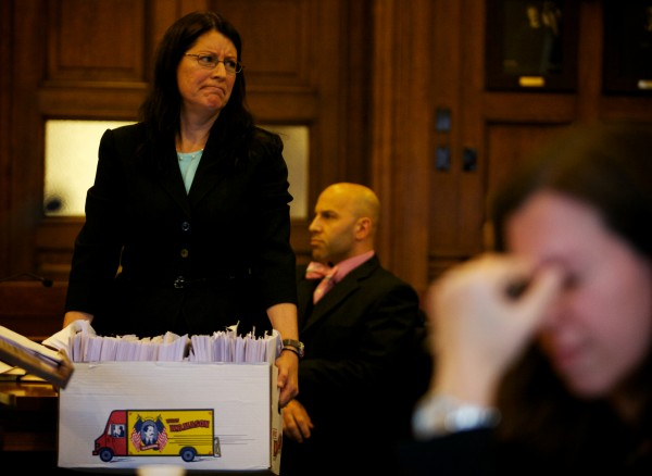 Deputy District Attorney Justina McGettigan scowls at defense attorney Daniel Lilley's assertion that the box of evidence delivered to his office from the prosecution was unorganized, unstamped and incomplete during arraignment procedures Tuesday, Oct. 9, 2012, in Cumberland County Superior Court in Portland.
