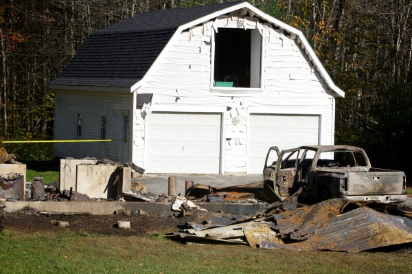A charred foundation and burned-out truck at 645 Goodwins Mills Road in Dayton remain Wednesday Oct. 17, 2012, after Donald Henson, 47, of Saco allegedly held his estranged wife and mother-in-law hostage during an armed standoff with police Tuesday night.