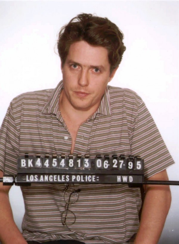 This June 27, 1995 file photo shows a Los Angeles police booking photo of British actor Hugh Grant who was arrested by Hollywood vice officers and charged with lewd conduct involving a prostitute. Interviews and surveys of officers at 200 police departments nationwide since 2008 found most consider targeting customers the best way to curb prostitution, because they fear publicity about the charges more than fines or even jail time.