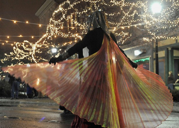 Street performers with House of Paradigm display their costumes in West Market Square as part of New Year's Eve festivities Saturday, Dec. 31, 2011.