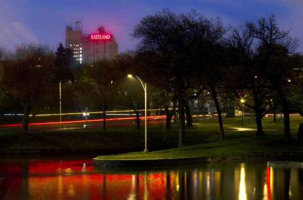 The sign atop the Eastland Hotel glows on a misty night in this six-second time-exposure made in Deering Oaks Park in May 2012 in Portland.