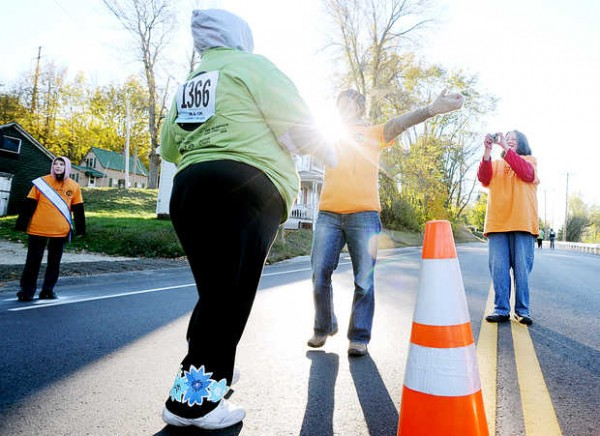 Brenda Weis of Whitefield reaches to give Leigh Moore of Auburn a hug during the Dempsey Challenge 5K walk along Lincoln Street in Lewiston on Saturday, Oct. 13, 2012. Moore and Keri Smith of Lewiston formed the team Positive Trackers and walked in memory of Moore's aunt, Paula Blowers, who died of cancer in July and Smith's father, Stuart Smith, who died 14 years ago of leukemia.