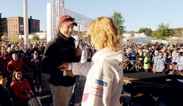 Actor Patrick Dempsey shares a moment with cancer survivor Kristen Short of Norway after she sang the national anthem to kick off the Dempsey Challenge in Lewiston on Saturday, Oct. 13, 2012.