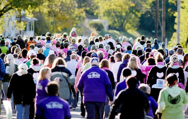 People make their way up Lincoln Street during the Dempsey Challenge 10-kilometer walk in Lewiston on Saturday, Oct. 13, 2012.