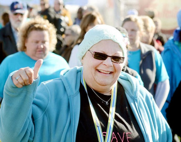 Cancer survivor Betty Keller of Enfield gives a thumbs-up during the Dempsey Challenge cancer survivor walk in Lewiston on Saturday, Oct. 13, 2012.