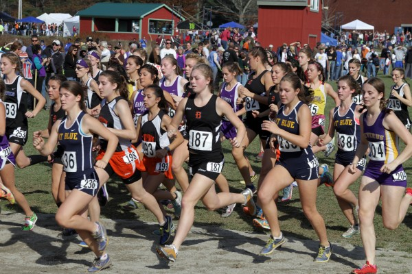 Runners take off during the start of the Class A girls race during Saturday's state championships at the Troy Howard Middle School course in Belfast. Bonny Eagle of Standish won the team title.