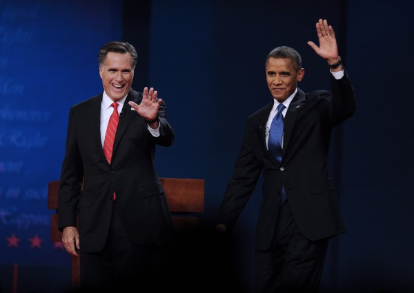 Republican presidential candidate Mitt Romney and U.S. President Barack Obama attend the first presidential debate at Denver University on Wednesday, Oct. 3, 2012, in Denver, Colo.