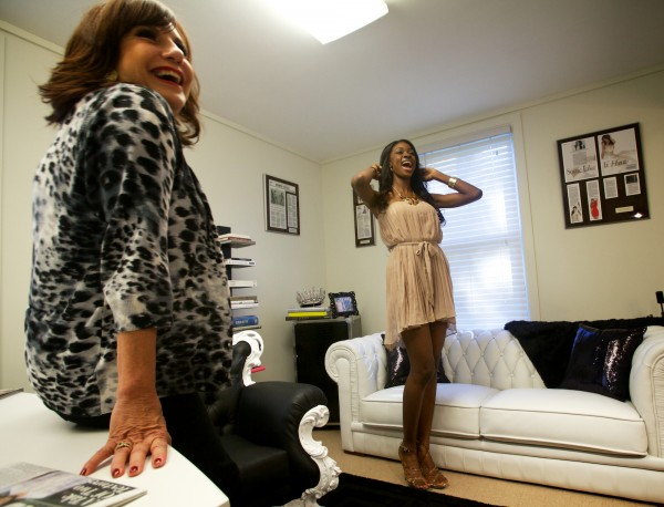 Pageant and lifestyle coach Grace Fontecha (left) shares a laugh with Miss Bahamas Universe, Celeste Marshall, while working on the best way to sit on a low couch on Wednesday Oct. 24, 2012 in Scarborough.