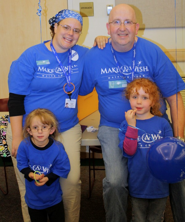 Volunteer wish granters and wish parents Pete and Kris Lento take part in the Walk For Wishes in Presque Isle with their daughters Paige, a Make-A-Wish recipient, and Cloe (right). Pete organized the walk.