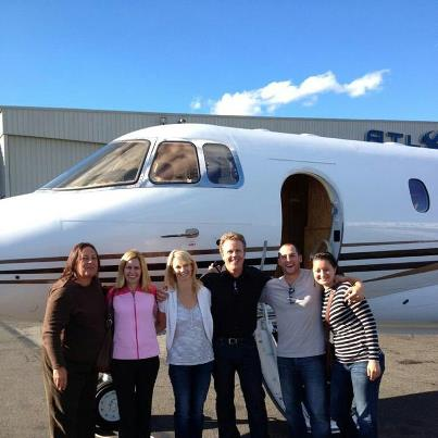 Grand-prize winners and their guests from the first-ever Maine Suitcase Party in Portland outside Maine Aviation's Hawker 1000 private jet, which transported them to and from NYC for a weekend, are Deborah McKenzie (from left) of Gorham with sister Wendy McKenzie of Warren, Sonja and Tim Devine of Portland and Calvin Hunter and Carley Kjeretzian of Auburn.
