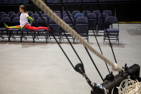 A Cirque du Soleil performer stretches before practice in Portland Monday Oct. 8, 2012.