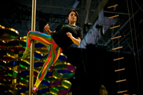 A Cirque du Soleil performer practices high off the stage in Portland on Monday, Oct. 8, 2012. Saltimbanco, Cirque du Soleil's longest running show, has been on the road for 20 years and makes its first appearance in Maine Wednesday through Sunday at the Cumberland County Civic Center in Portland.