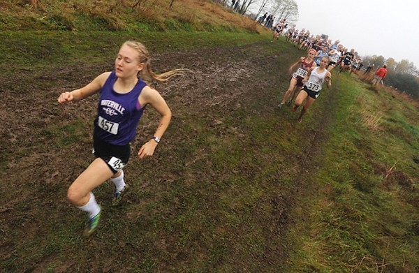 Eventual winner Bethanie Brown (left) of Waterville High School pulls away from the pack about a half minute after the start of the Eastern Maine girls Class B cross country championship race in Belfast last Saturday. Brown, who is undefeated this season, returns to Belfast Saturday for the state championship races.