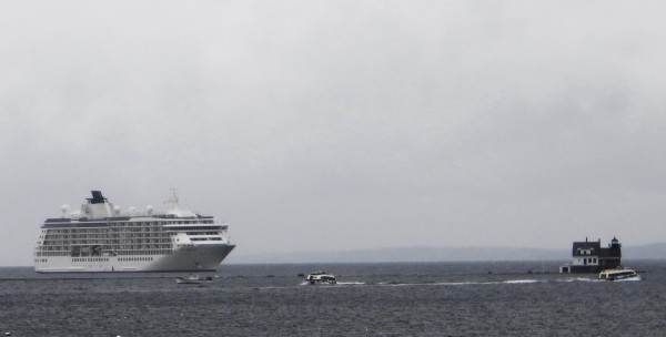 The World, a 644-foot-long floating condominium, anchored off the Rockland breakwater Saturday, Oct. 13, 2012. On Sunday morning, despite rain, tenders ferried residents of the privately owned ship to and from Rockland.