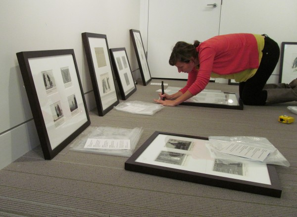 Rachael Weyand, program manager at the Portland Public Library, prepares an exhibit of the work of famed illustrator Edward Gorey on Monday afternoon, Oct. 1, 2012, in the library's Lewis Gallery. Maine College of Art organizers believe the exhibit, running from Oct. 5 until Dec. 29, will be the first show of original Gorey work in Maine.
