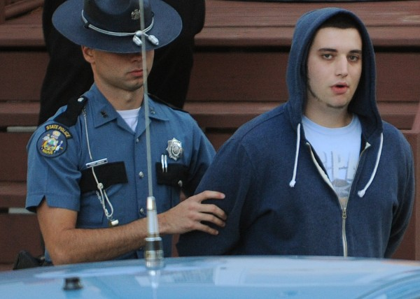 Maine State Police trooper Tucker Bonnevie takes Maxwell Stein into custody on Thursday, Oct. 25, 2012 at 69 New Boston Road in Hermon in connection with a incident on Ohio Street in Bangor on Thursday that involved a person being dragged behind a car.