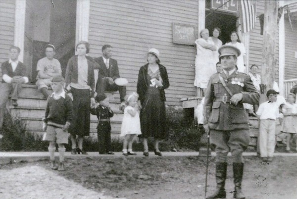 The inscription on the back of this 1930s photo reads: &quotBill Metcalf, Victoria Cross recipient, served in Canadian Army in WWI, stands in front of American Legion Hall on Green St. Eastport, ME, in his New Brunswick Militia Lieut's uniform ready to march in the 4th of July parade in the 1930's.&quot