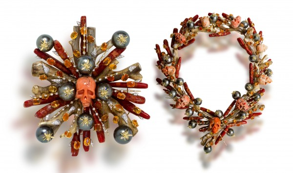 The Tony Duquette fire opal, cultured pearl and diamond brooch with carved coral skulls.
