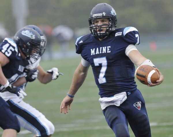 Maine quarterback Marcus Wasilewski takes the ball into the end zone for a touchdown in an NCAA college football game against Villanova in Orono in September 2012.
