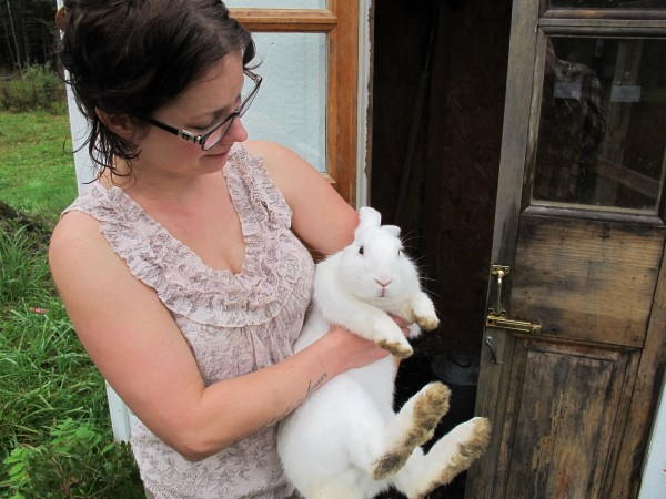 Jenny Nichols holds Lily, one of the more than 30 rabbits living at Cottontail Cottage Rabbit Rescue, a rabbit shelter Nichols runs out of her Lamoine home, on Oct. 5, 2012.