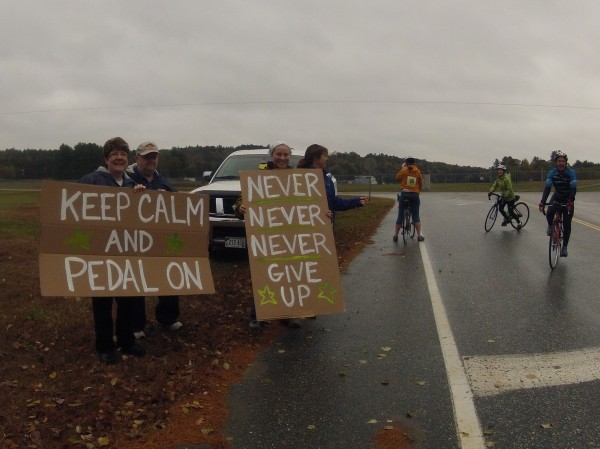 Scores of people lined the route of the Dempsey Challenge bicycle ride on Sunday, Oct. 14, 2012, braving rain and wind to support the riders on the 10-, 25-, 50-, 70-, ad 100-mile courses. The riders were cheered on with words of support, cowbells and noisemakers.
